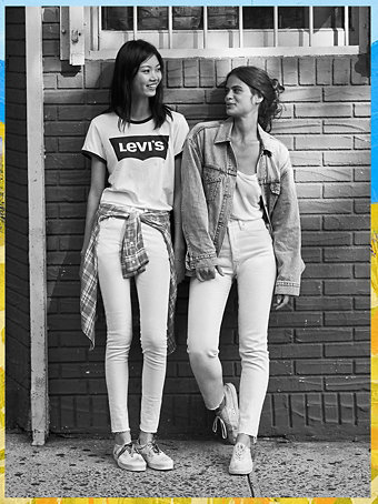 Two girls wearing Levi Tees and skinny jeans and one of them also wearing trucker jacket