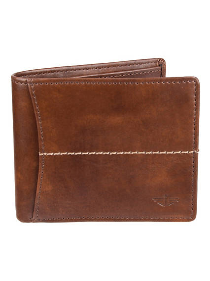 Designed to keep your money and information safe. An RFID shield protects your data from electronic theft Features an embossed Dockers logo on front Built with a large bill compartment\\\\, an ID window with thumb slide for quick access\\\\, 2 slip pockets\\\\, and an extra middle flap with 3 additional card slots Men\\\'s Traveler Wallet One Size - Black. Dockers Official Site.